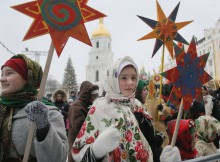 Ukrainians in folk costumes hold symbols of the star of Bethlehem as they celebrate Orthodox Christmas in central Kiev, Ukraine, Saturday, Jan. 7 2017. Orthodox Christians mark their traditional Christmas Day Jan. 7, with many ancient symbolic events. (AP Photo/Efrem Lukatsky)
